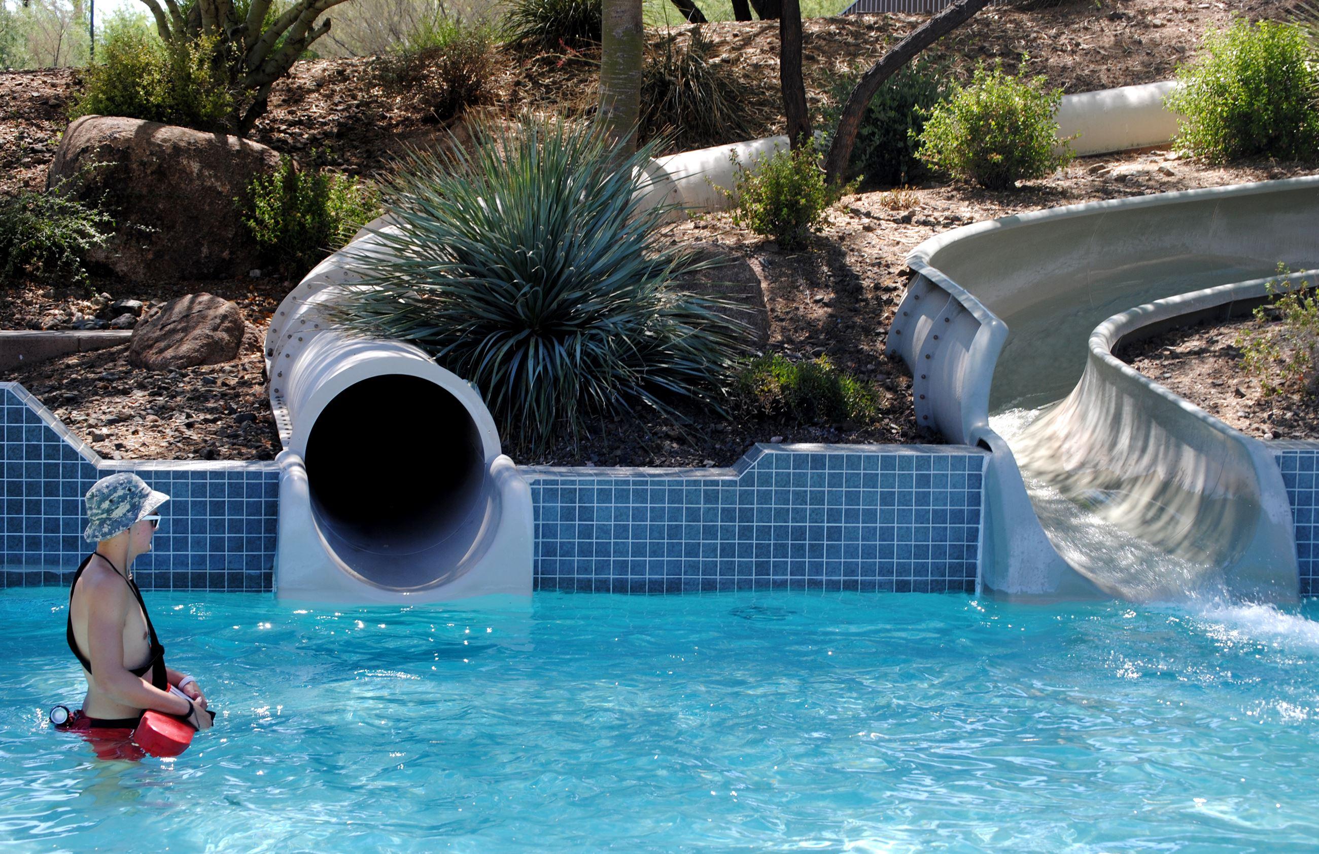 Lifeguard In Slide Pool